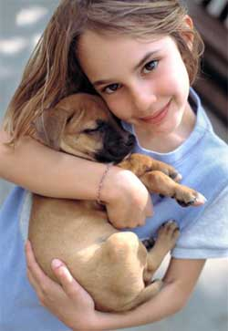 young girl with puppy